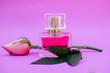Leinwandbild Motiv Essential oil in bottles extracted from rose