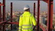 Male builder engineer man contractor worker foreman architect in hard hat with drawing blueprint plan on construction site working, Industrial building city skyscraper outdoors. engineering 4 k Slowmo