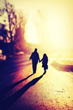 Tilt Shift Of Mother And Daughter Walking On Street During Sunny Day