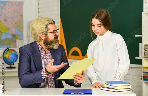 Bearded man teacher in classroom Canvas Print