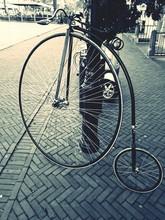 Penny Farthing Bicycle On Sidewalk
