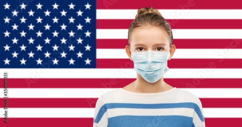 health protection, safety and pandemic concept - teenage girl in protective medical mask over flag of united states of america background