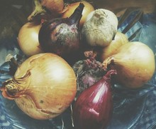 High Angle View Of Rotting Onions On Table