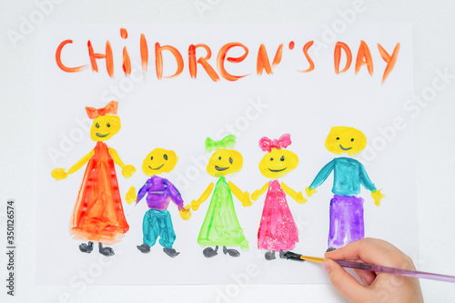 Fototapeta Top view of hand of child drawing the different children with words Children's Day for the holiday Happy Children's Day. obraz