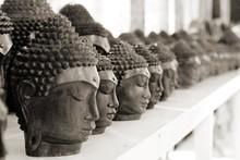 Wooden Head Sculptures In Row On Shelf