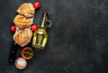 Skinless Grilled Chicken Thighs With Spices Over A Meat Knife On A Stone Background With Copy Space For Your Text