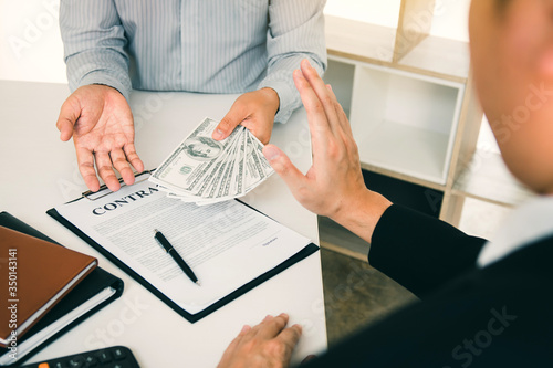 Valokuva Business person refusing bribe given money by partner with anti bribery corruption concept
