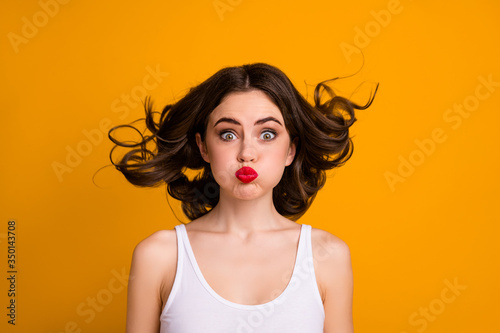 Fototapeta Closeup photo of funny crazy childish lady hairstyle flight mouth lips closed hold breath not breathing wear white casual tank-top isolated yellow color background obraz