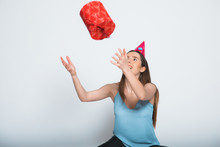 Smiling Woman Hold Red Gift Bo...