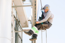 Industrial Climber In Helmet A...