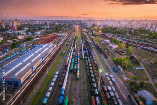 Fotografía Aerial view of freight trains at sunset