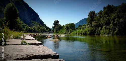 Tela Idyllic View Mountains And Tree At River Brenta Against Clear Sky
