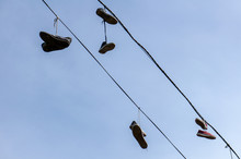 Silhouettes Of Shoes Hanging O...