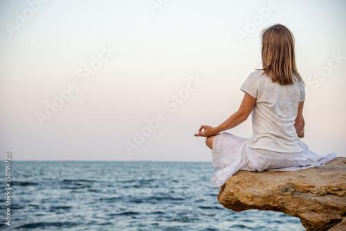 serenity and yoga practicing at the sea. sunrise Fotobehang