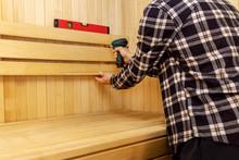 Sauna Construction - Man Screw...