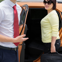 The Driver Opens The Door To The Girl, Taxi Service, Transfer