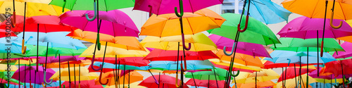 Obrazy kolorowe  a-place-in-the-center-of-paris-with-colorful-umbrellas-instead-of-ceiling-yellow-red-pink