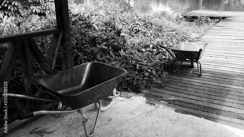 Fotografering High Angle View Of Wheelbarrow On Lakeshore