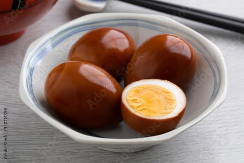 Fototapeta Bowl with whole and half soy sauce eggs, Shoyu tamago obraz