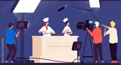 Fototapeta Cooking show. Chef live tv entertainment. People in uniform cook on kitchen. Flat shooting with spotlights in restaurant vector illustration. Tv show cooking, chef professional television obraz