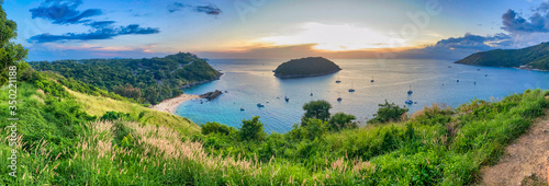 Fototapeta Amazing aerial view of Phuket coastline from Windmill Viewpoint at sunset. Panoramic view obraz