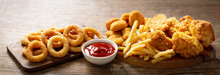 Fast Food Meals : Onion Rings, French Fries, Chicken Nuggets And Fried Chicken