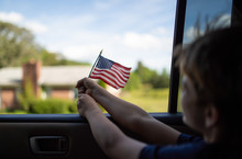 Young Boy Flying American Flag...