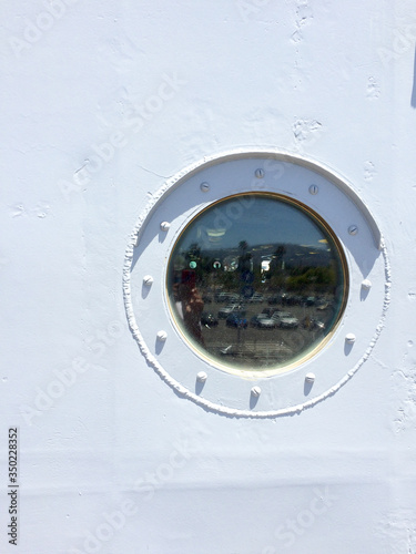 Canvas Print Porthole on metal ship with round circle glass on USS Iowa naval warship destroy