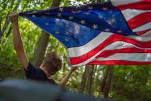 Boy Flying American Flag In Th...
