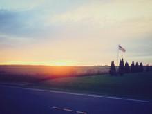 American Flag Waving On Grassy...