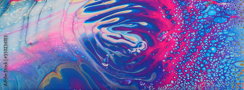 art photography of abstract marbleized effect background. Violet, white, pink and blue creative colors. Beautiful paint