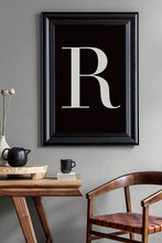 Stylish And Minimalistic Dining Room Interior With Wooden Table, Chair, Tea Pot With Cups, Flowers, Black Mock Up Poster Frame And Elegant Accessories In Modern Home Decor.