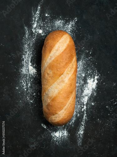 Fotografie, Obraz British White Bloomer or European Baton loaf bread on black background