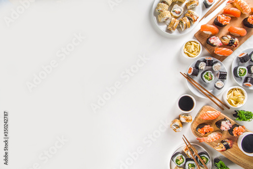 Fototapeta Japanese food. Big sushi set. Assorted set of various sashimi, maki and sushi rolls with different fillings - tuna, sea bass, salmon, shrimp, vegetables. Flatlay copy space obraz