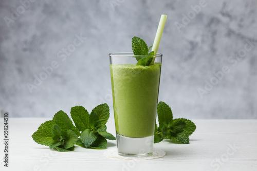 Freshly blended green fruit smoothie in glass. Wallpaper Mural