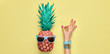 Leinwanddruck Bild Fashion. Pineapple hipster in sunglasses, sfemale hand, OK gesture. Minimal concept, summer tropical pineapple. Creative art fashionable concept. Summertime color, pineapple OK banner