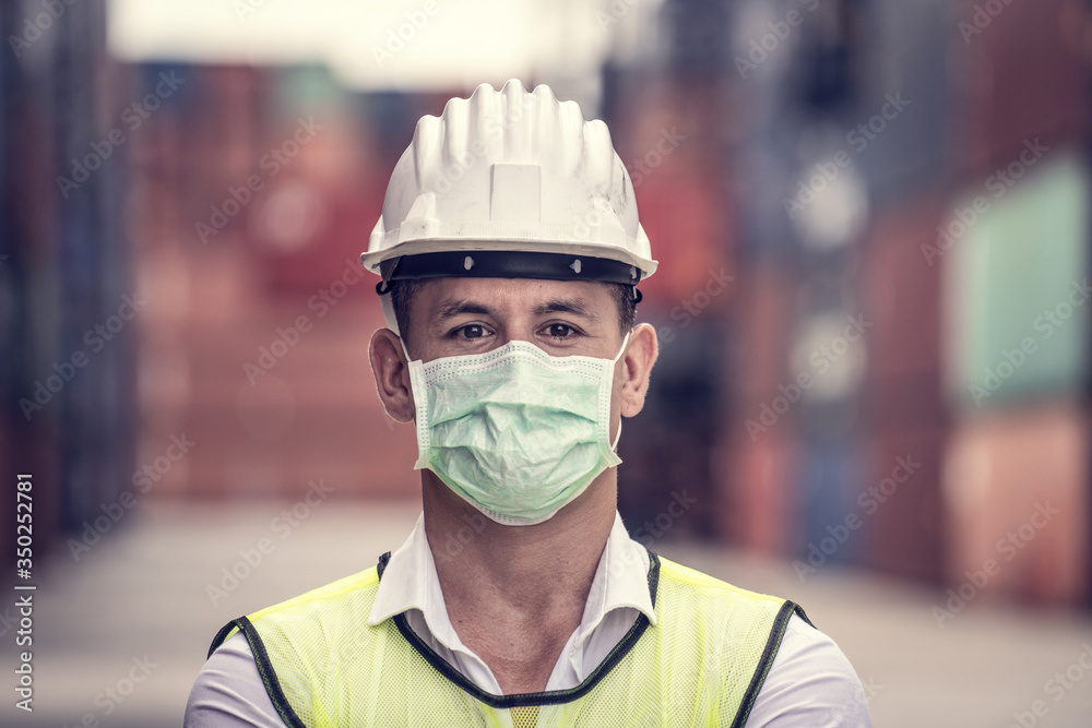 Fototapeta Coronavirus Disease or COVID can spread easily without mask. Quarantined masked workers protect spreading of Covid 19 by wearing face masks. Workers are engineer wear masks during quarantine time