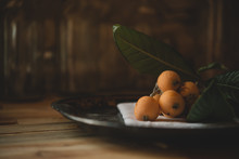 Close Up Of Loquat Fruits On P...