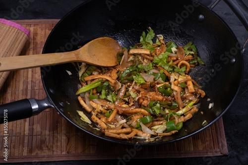 Vegan tofu and pepper stir fry in wok Canvas Print