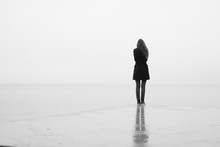 A Lonely Girl Looks Out Into T...