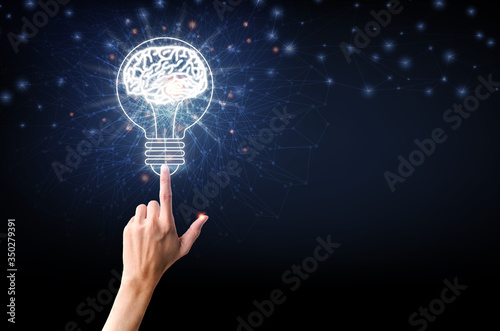 Photo Light bulb with brain, finger of person touching on light bulb and point connecting network on blue background