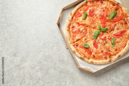 Fototapeta Delicious pizza Margherita on light grey table, top view. Space for text obraz