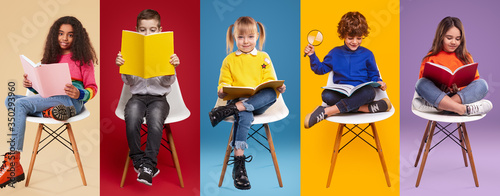 Fototapeta Diverse stylish kids reading textbooks