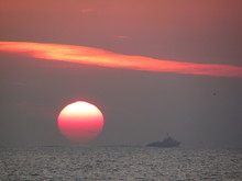 Ferry Sailing In Sea During Sunset