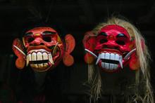 Close-up Of Masks Against Black Background