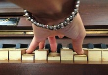 Close-up Of Cropped Hand Playi...