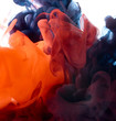Color drop in water. Abstract background.