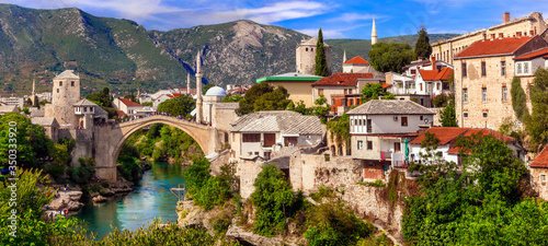 Fototapeta Beautiful iconic old town Mostar with famous bridge in Bosnia and Herzegovina, popular tourist destination obraz