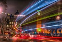 Light Trails On Street Against Illuminated Big Ben At Night