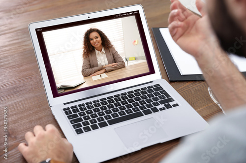 Fotografía Man using video chat for online job interview in office, closeup